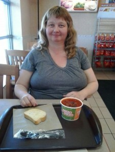 Linda Randall Blogger enjoying her favorite pizza pizza CHILI & GARLIC BREAD LUnch Deal $3.99 in Fort Erie Ont Canada