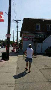 harold chisholm walking main st w sunflower cafe selkirk ontario